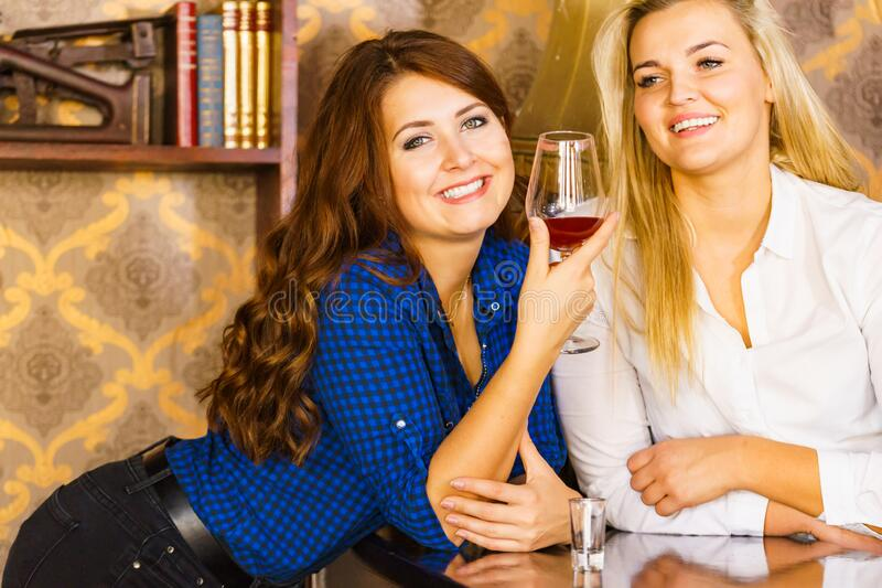 Girls in pub club gossiping and talking royalty free stock photos