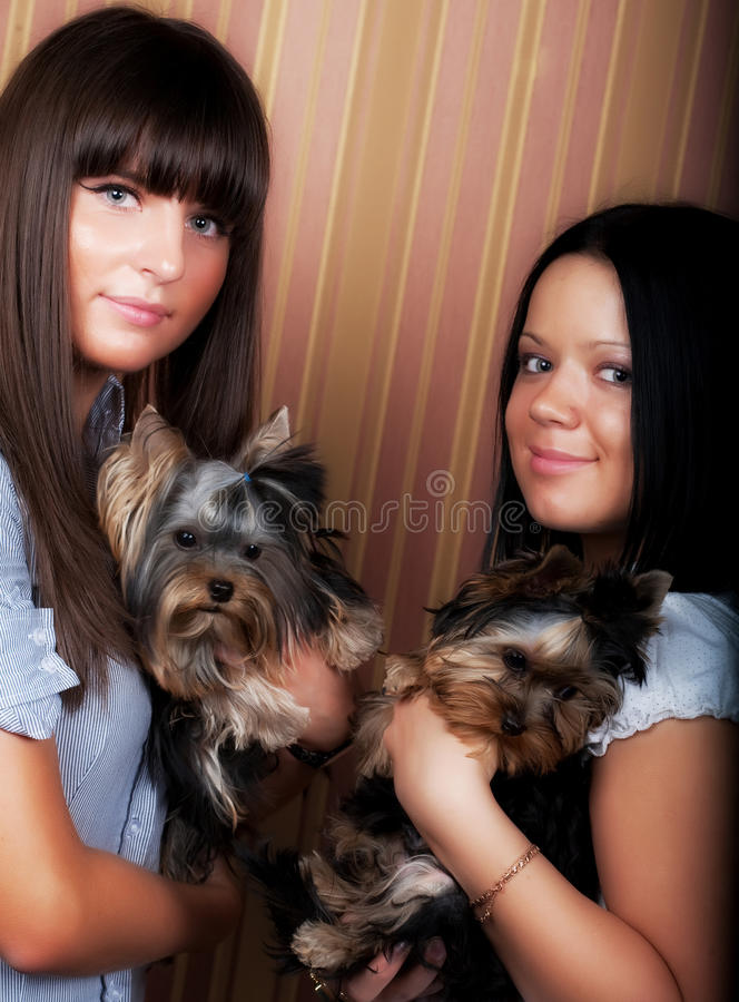 Girls with puppys royalty free stock photography
