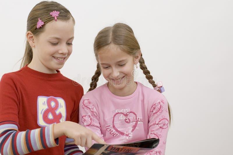 Girls / reading stock image