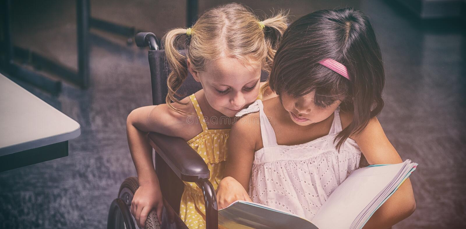Girls reading in the classroom royalty free stock photography