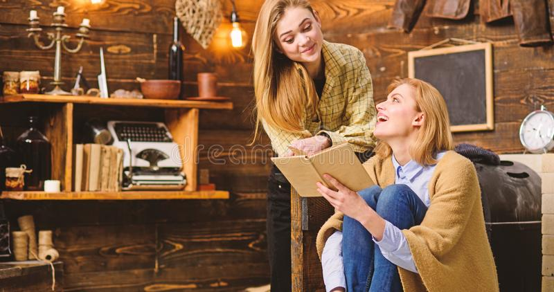 Girls reading together, family leisure activity. Teenager studying literature with her mom, home education concept. Mother and daughter looking at each other stock photos