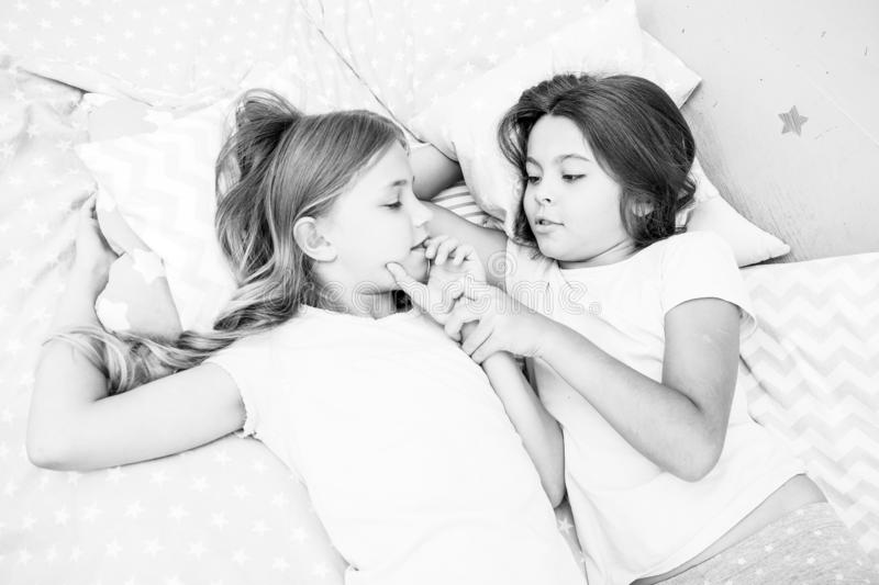 Girls relaxing on bed. Slumber party concept. Girls just want to have fun. Invite friend for sleepover. Best friends. Forever. Consider theme slumber party stock photos