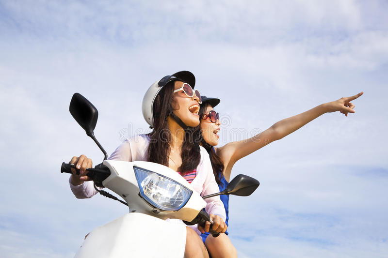 Download Girls Riding Scooter Enjoy Summer Vacation Stock Image - Image: 20711617
