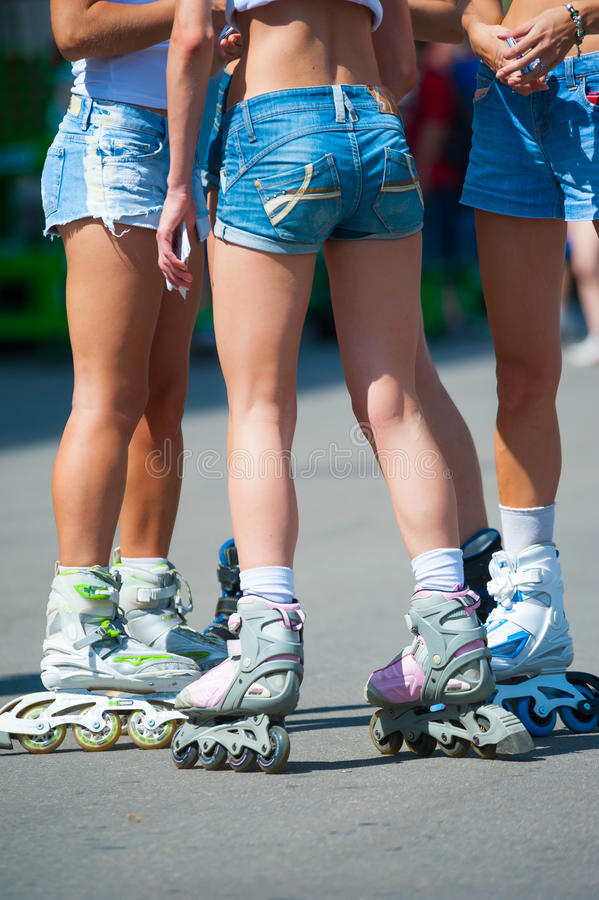 Girls on roller skates royalty free stock images