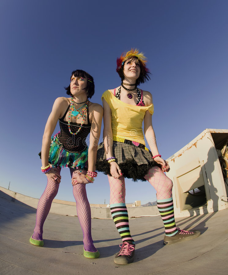 Girls on the Roof. Fisheye shot of girls in brightly colored clothing on a roof stock photography