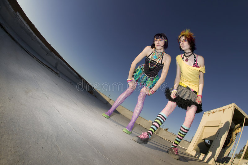 Girls on the Roof. Fisheye shot of girls in brightly colored clothing on a roof stock photo