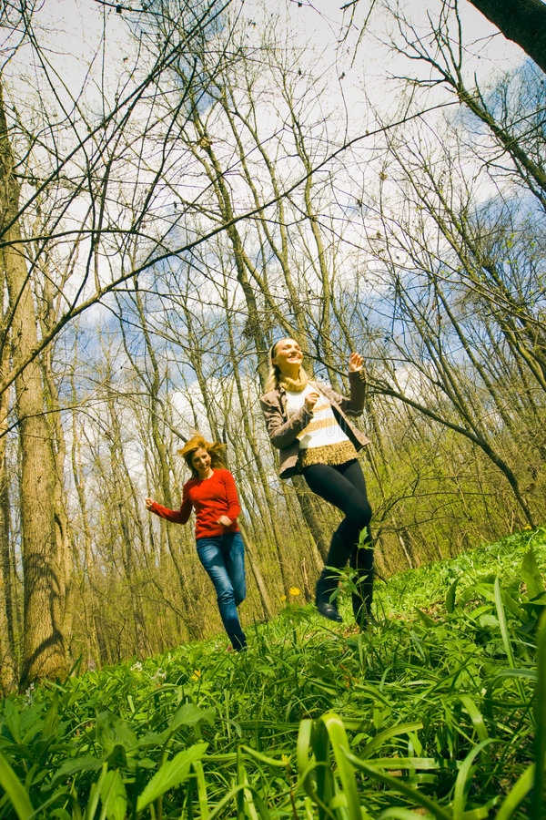 Girls running through forest stock photo