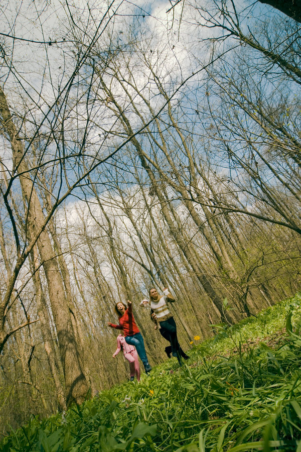 Girls running in the forest stock image