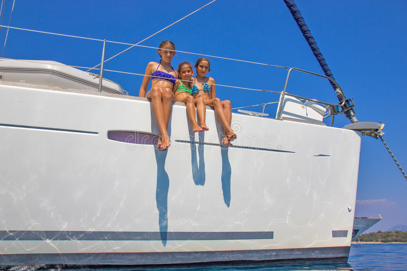 Girls on the sailboat royalty free stock photography
