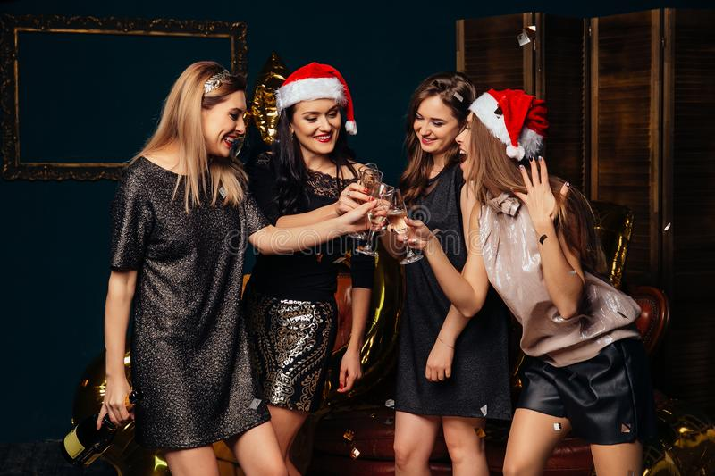 Girls in Santa`s hat have fun at New year party stock photos