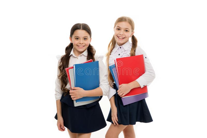 Girls with school textbooks white background. We love study. Studying is fun. Buy book for extra school course. School royalty free stock image