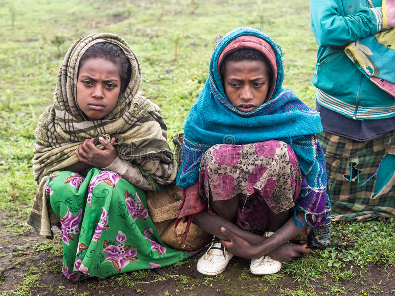 Girls selling souvenirs in Semien Mountains, Ethiopia, on a foggy day. royalty free stock images