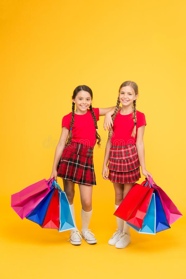 Girls with shopping bags. Rediscover great shopping tradition. Gifts and souvenirs. Shopping with friend. Children hold. Packages. Best day ever. Shopping and royalty free stock photo