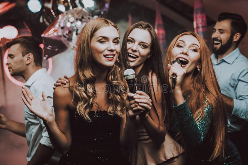 Girls Sing. Have Fun. Cheerful. Smile.Party Maker. Cheerful. Smile. Smiling Girl. Singing Songs. Beautiful Girls. Friends at Karaoke Club. Karaoke Club stock images