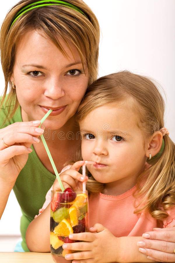 Girls Sipping Fruity Refreshment Stock Photography