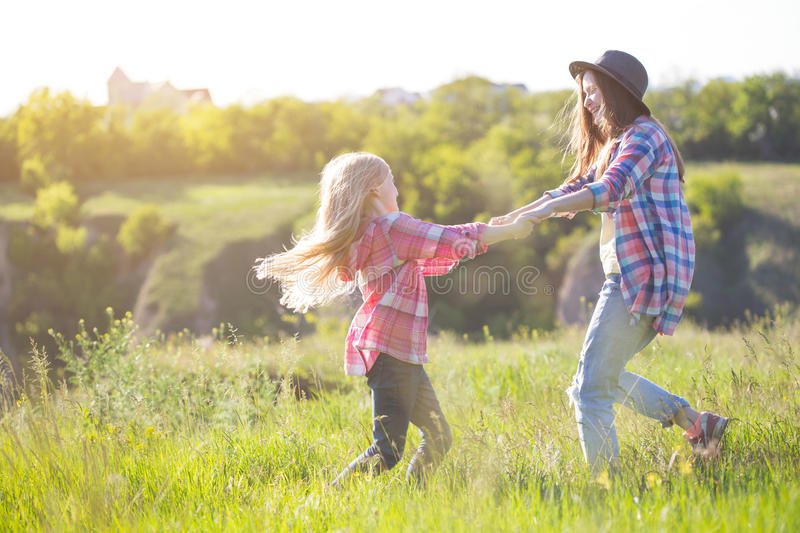 Girls sister at the meadow royalty free stock photos
