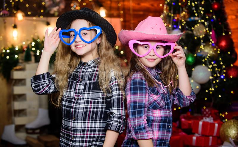 Girls sisters carnival hats costumes new year party. Kids friends celebrate winter holiday. Family celebrate Christmas royalty free stock images