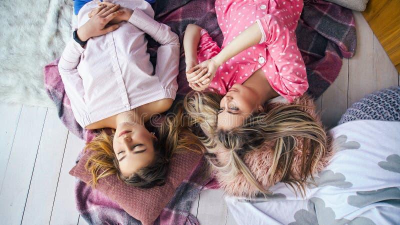 Girls sleepover female best friends floor chatting stock image
