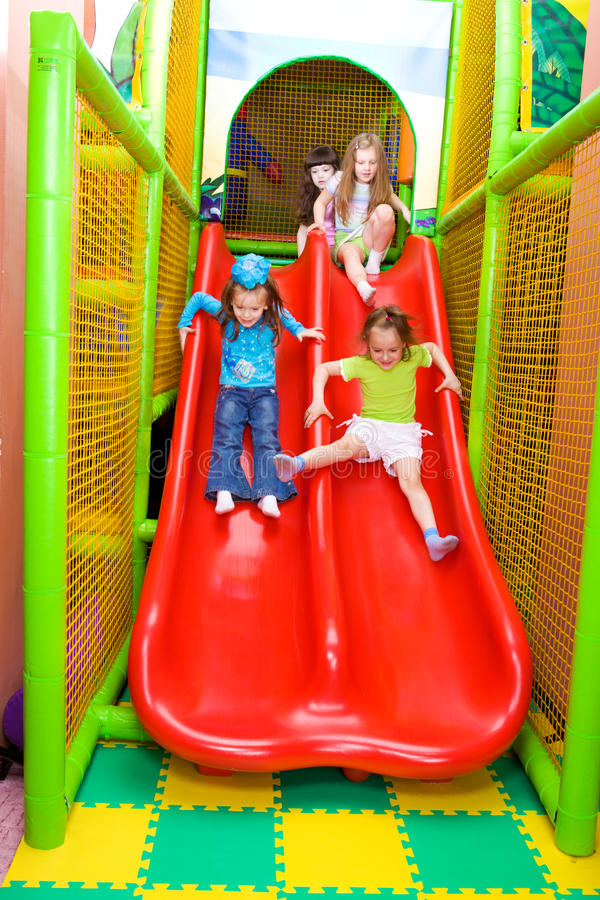 Girls sliding down royalty free stock images