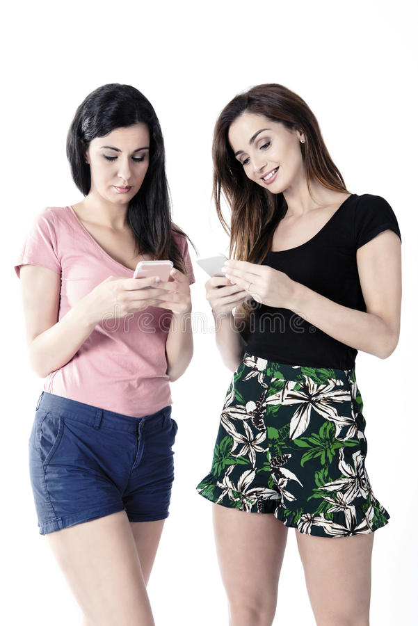 Girls with smartphones royalty free stock photography