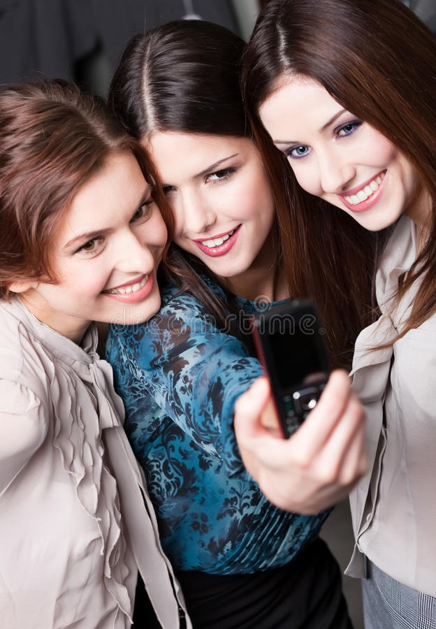 Girls snap themselves after shopping stock photography