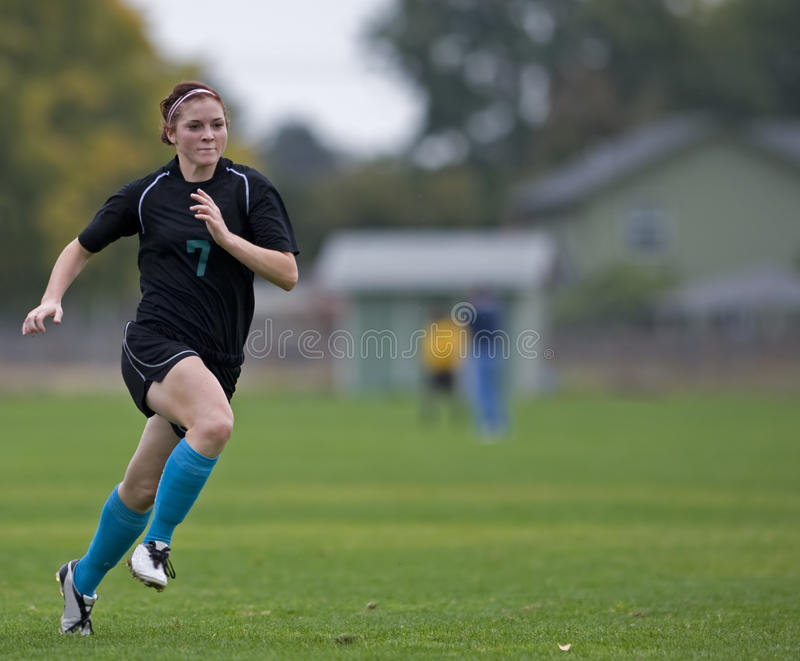 Girls Soccer Player Running Royalty Free Stock Image