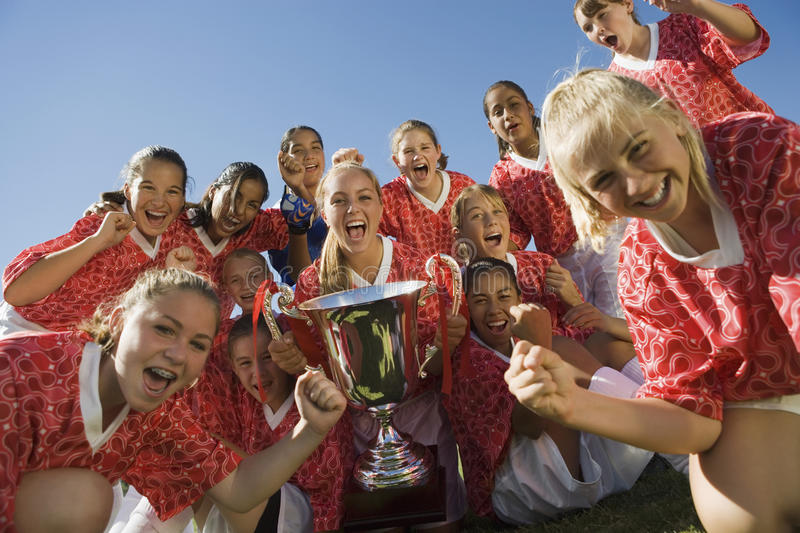 Girls' Soccer Team Holding Trophy stock photography