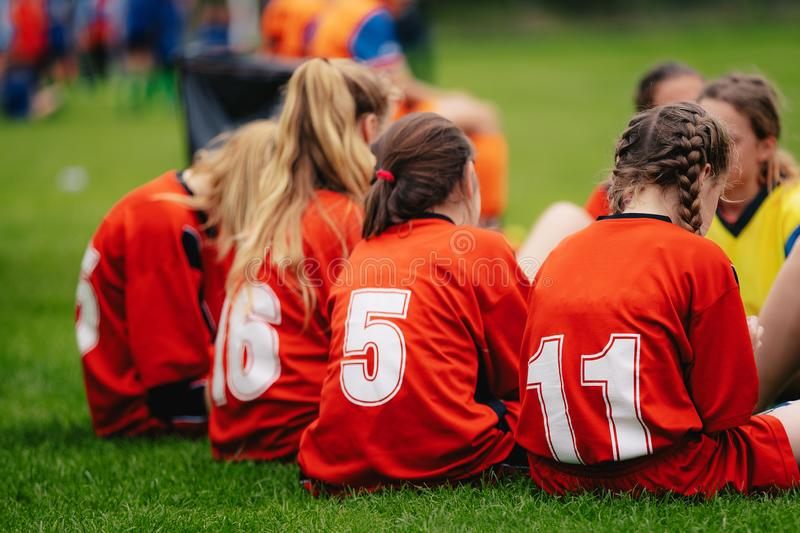 Girls in sports soccer team outdoors. Female physical education class on sports grass field. Young football players of female youth sports team royalty free stock photography