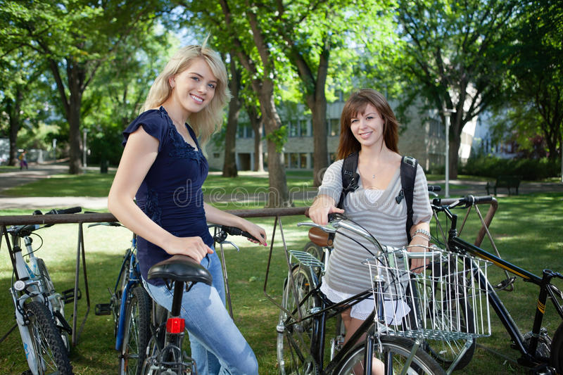 Girls Standing With Bicycle Stock Image Image of caucasian