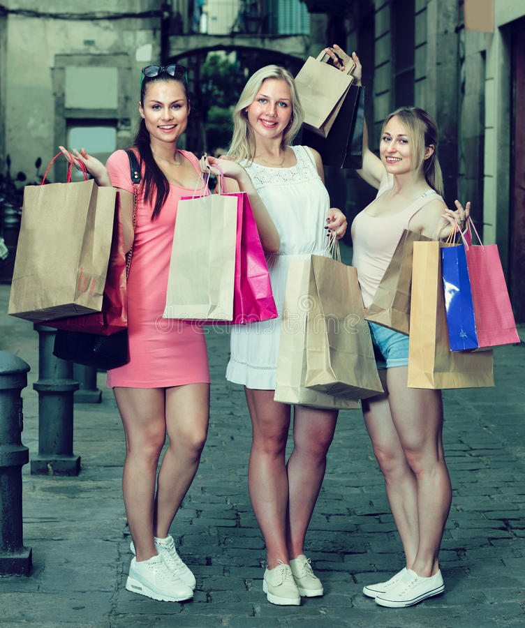 Girls standing with shopping bags royalty free stock images