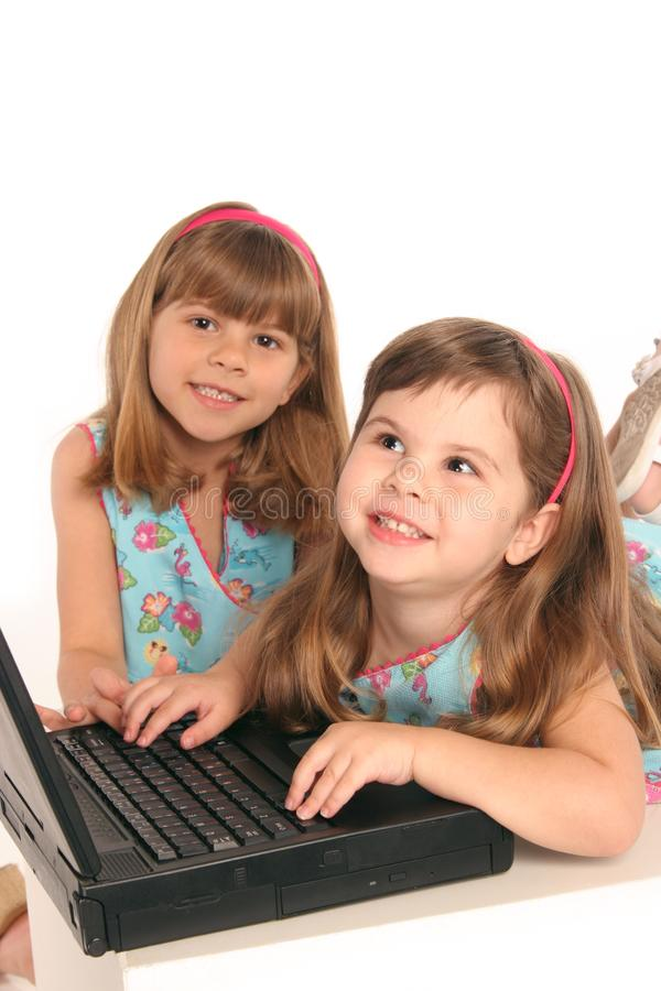 Girls study with computer laptop royalty free stock image