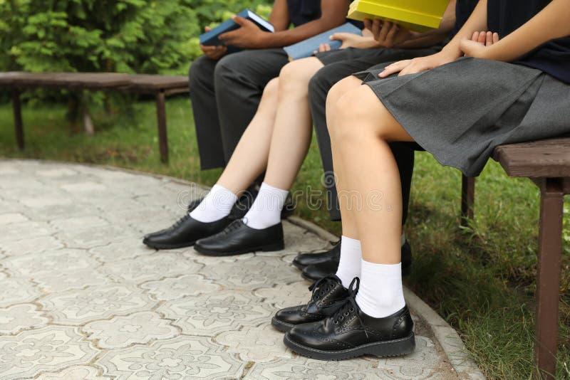 Girls in stylish school uniform outdoors stock photography