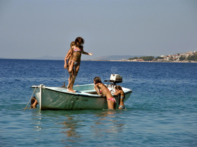 Girls in summer vacation on boat in sea