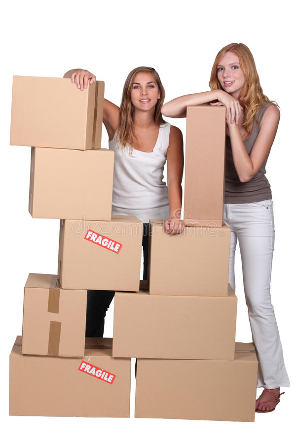 Download Girls Surrounded By Boxes Stock Images - Image: 27917144