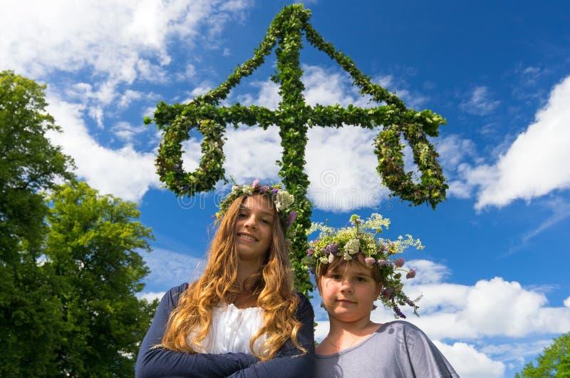 Girls in Swedish midsummer. Adorable girls on midsummer Swedish party stock photos