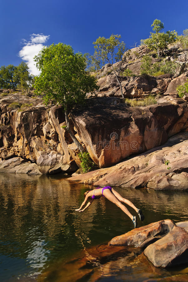 Girls swimming in Billabong, Kakadu National Park. Girls swimming in Billabong at gunlom fall, Kakadu National Park, australia stock photography