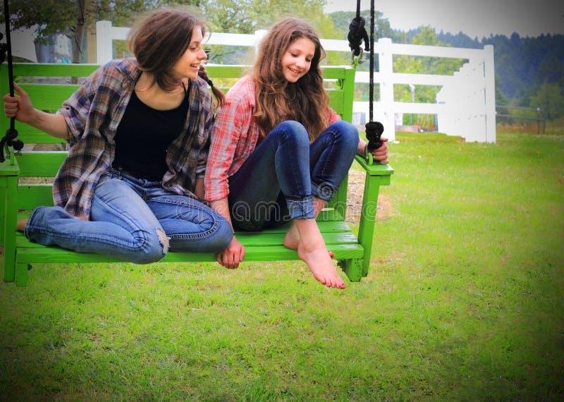 Girls on Swing stock photo