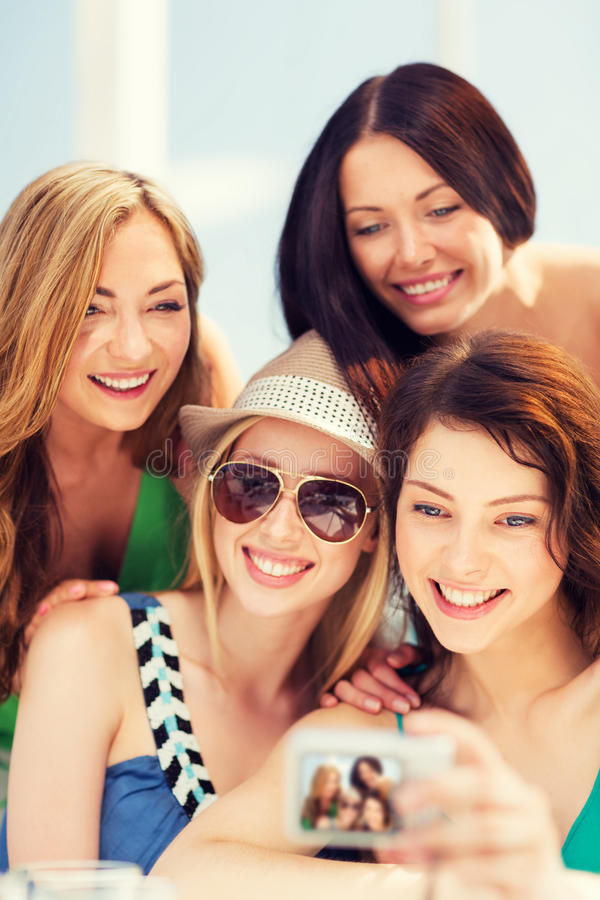 Download Girls Taking Photo In Cafe On The Beach Stock Image - Image of dinner, people: 40043037