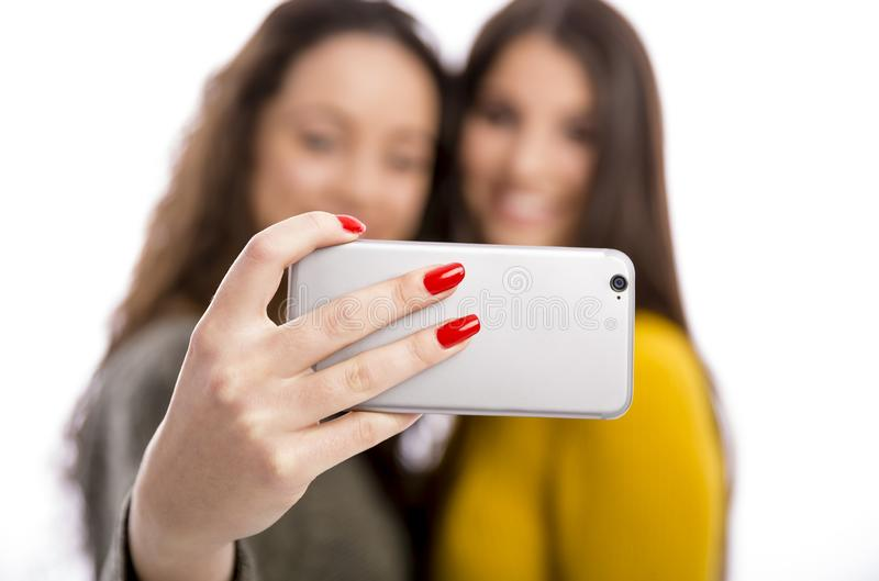 Girls taking selfie royalty free stock image