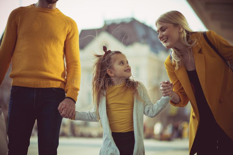 Girls talks. Family shopping in the city royalty free stock photography