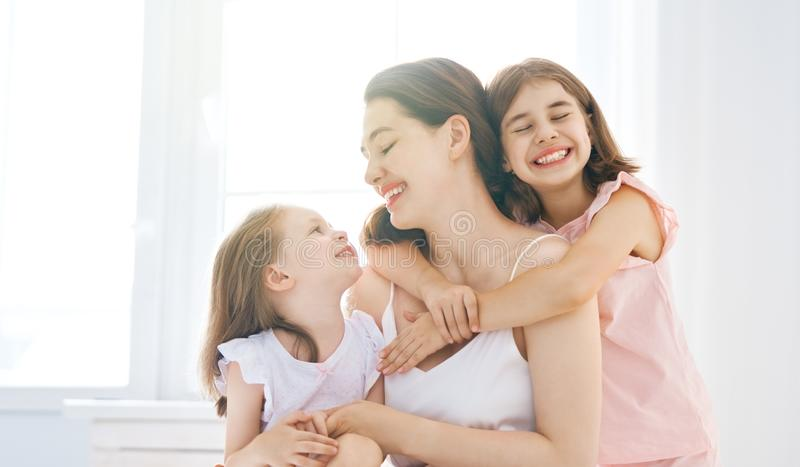 Girls and their mother enjoy sunny morning royalty free stock image