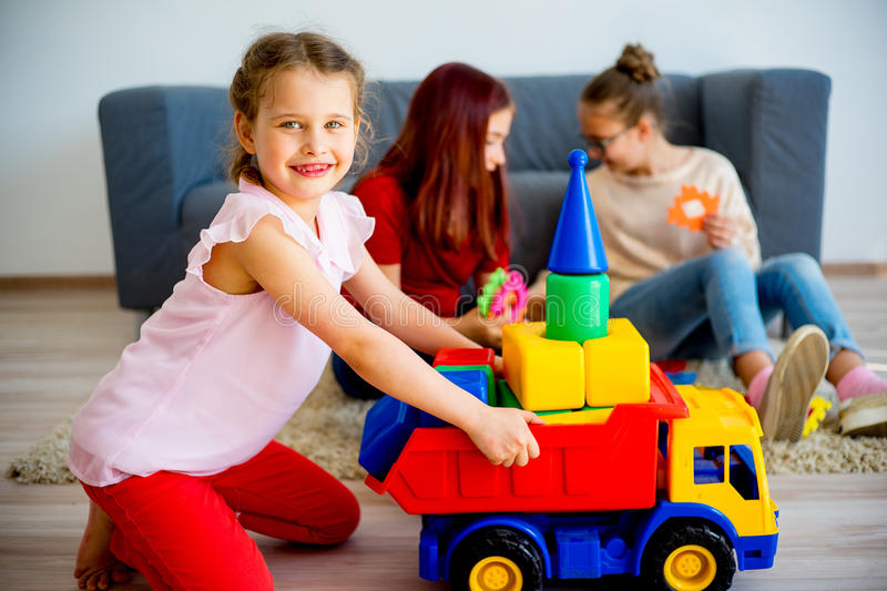 Girls with toy car stock image