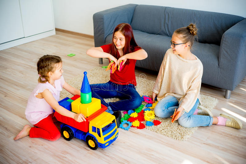 Girls with toy car stock photography