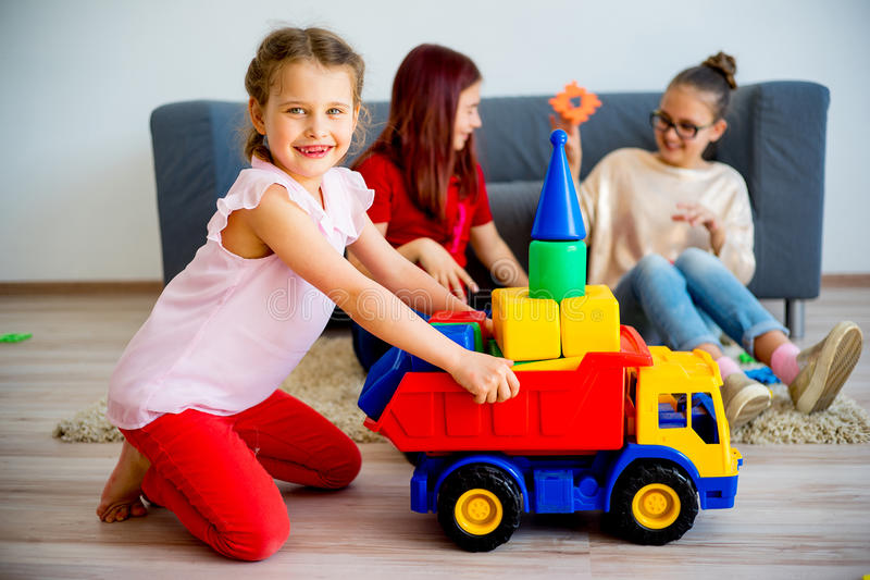 Girls with toy car royalty free stock photography
