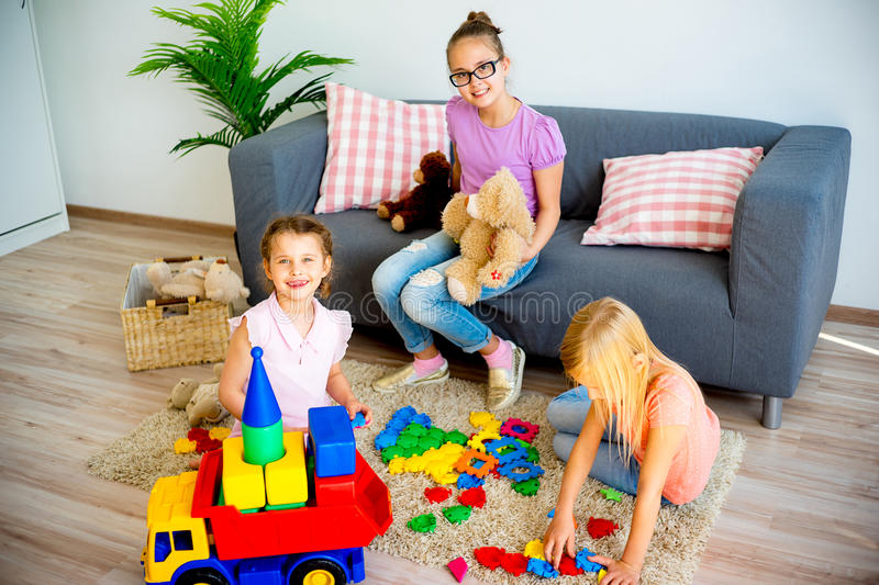 Girls with toy truck stock photos