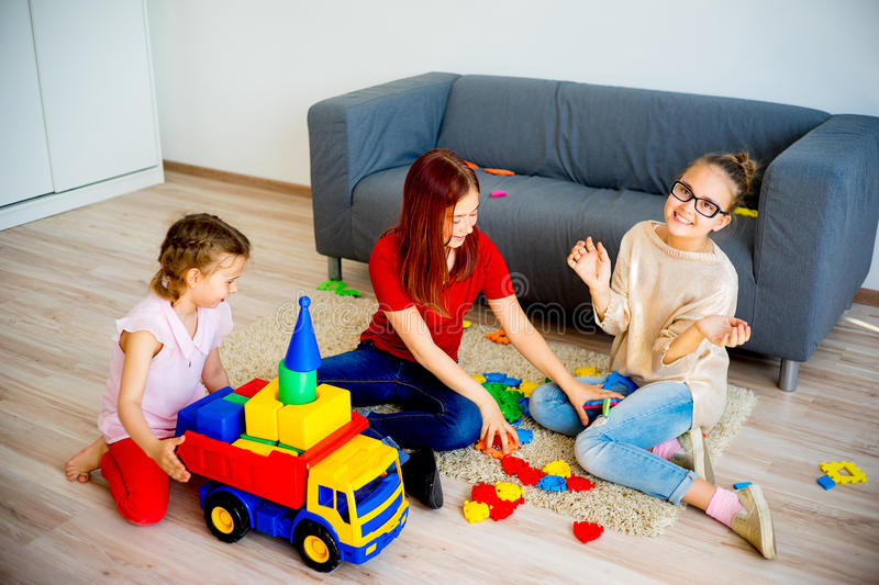 Girls with toy truck royalty free stock photos