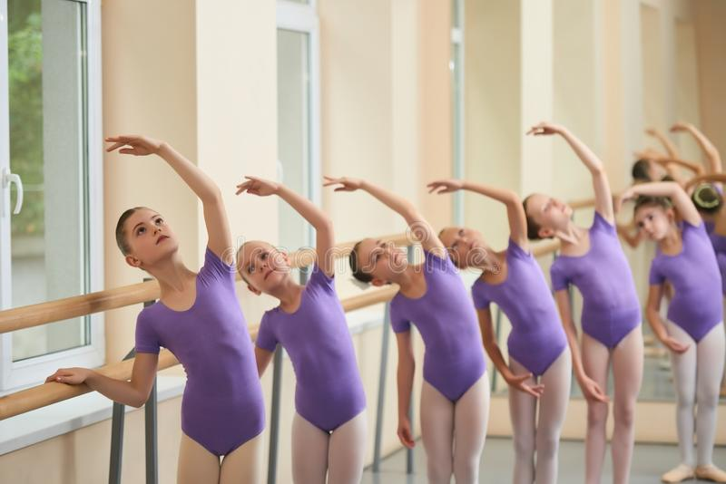 Girls training at classical ballet class. royalty free stock photography