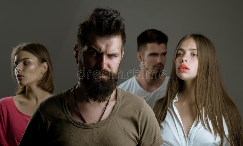 Girls with two men. Love relations of people. Hopes and wishes. depression and suicidal tendencies family psychologist. Therapy. club for people with problems royalty free stock photo