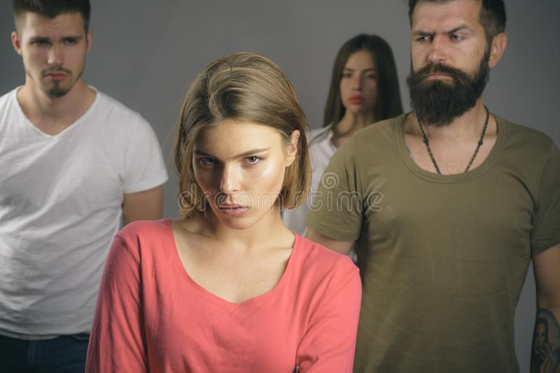 Girls with two men. Love relations of people. Hopes and wishes. family psychologist therapy. club for people with. Problems. depression and suicidal tendencies royalty free stock photo