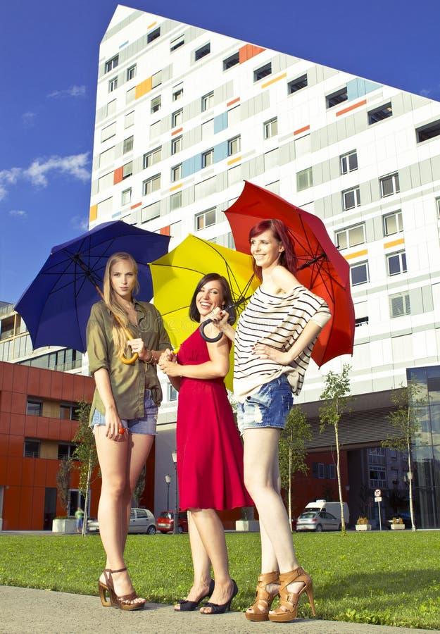 Girls with umbrellas royalty free stock photos